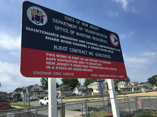 This sign at Belmar Marina explains the Shark River dredging project. Officials won't comment on the stalled project after abruptly cancelling a press conference this morning