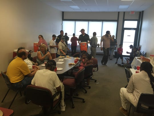 Public safety personnel, city leaders and residents shared a meal at Urban Dreams offices on Thursday, July 28, 2016.