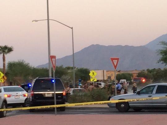 Riverside County sheriff's personnel gather near the La Quinta scene where a stolen car-pursuit ended.