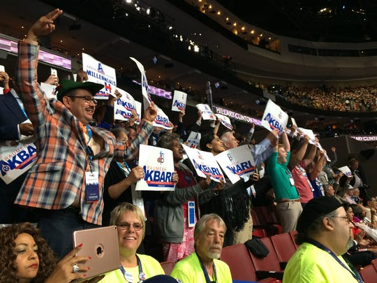 Members of the Tennessee democratic delegation hold signs for Memphis Rep. Akbari during her speech Thursday, July 28, 2016 in Philadelphia