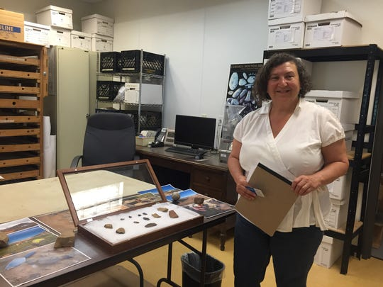 Ilene Grossman-Bailey shows some of the artifacts uncovered near the Holtec site last year. They are processed and cataloged at RGA Inc.'s offices in Cranbury.