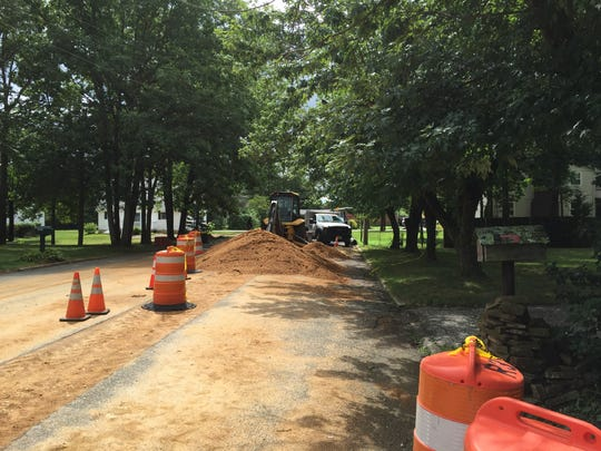 A two-man city Streets and Roads department crew resume work Friday on installing a stormwater drainage pipe at one end of Peach Drive.