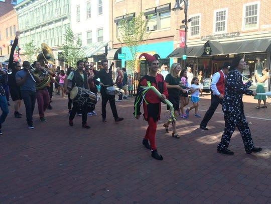Burlington Mayor Miro Weinberger, center, marches in