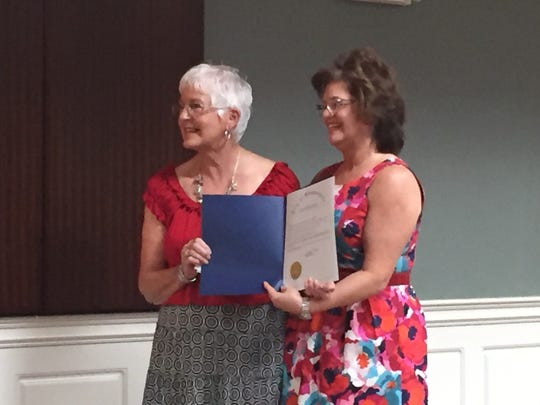 Simpsonville Farmer's Market Manager Dianne Carson, left, is presented with a proclamation by Simpsonville Mayor Janice Curtis.