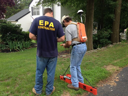 EPA contractors Kyle Harmish (left) and John Williams