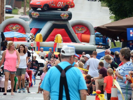 Crowds gather for the Mayor's Parade in West Branch