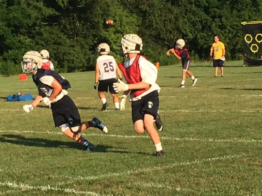 Granville runs a play during Monday evening's practice.