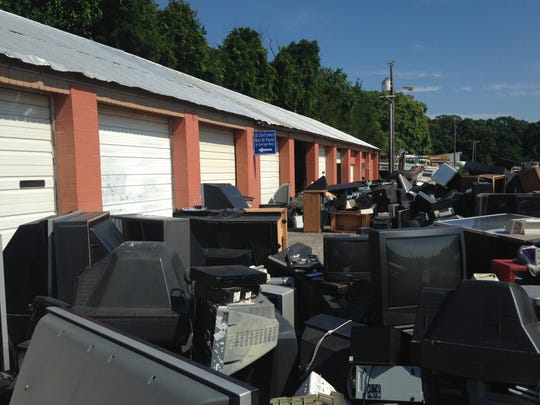Junked electronics have been sitting outside the public works facility for months.