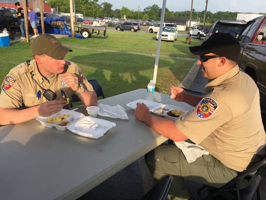 Rutherford County Deputies Chris Wright, left, and Erik Backlund enjoy breakfast prepared by the Rutherford County Sheriff's Citizens Academy Alumni Association.