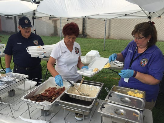 Rutherford County Sheriff's Citizens Academy Alumni Association members serving up breakfast to law enforcement officers Tuesday morning are, from left, Phil Barnett, E.T. Guice and Amy Swicord.