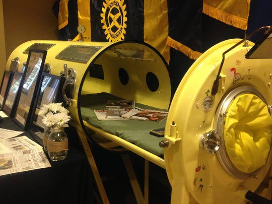 An iron lung sat outside the conference room during