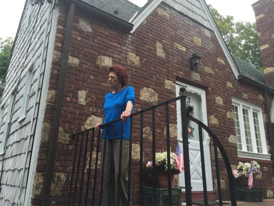 Barbar Cellura in front of her Yonkers home