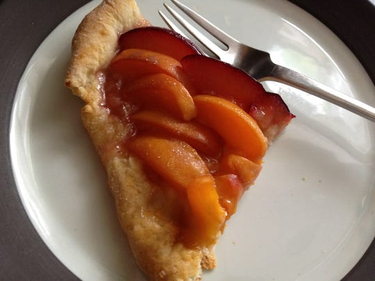 A slice of peach cake, made using Candace Page's grandmother's