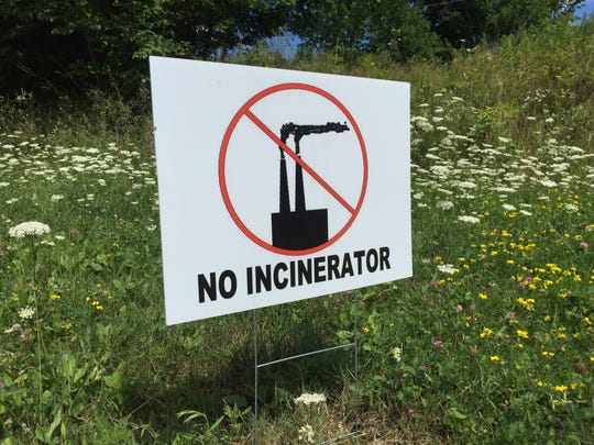 "Commercial and homemade ""No Incinerator"" signs dotted"