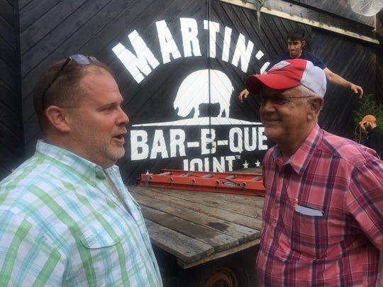 Pat Martin, left, speaks with Mike Bodnar of restaurant