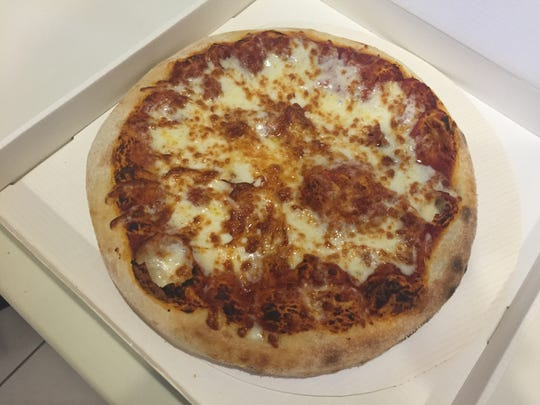 A medium pizza costs $9 in Xavier University's new Pizza ATM.