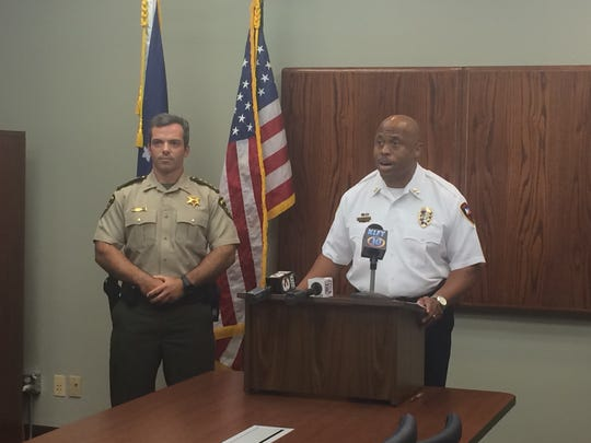 Lafayette, Louisiana, Police Chief Reginald Thomas speaks with the media at a news conference in August as Lafayette Parish Sheriff Mark Garber looks on.