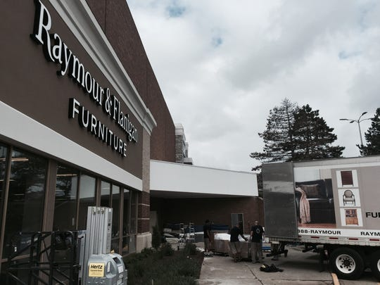 Trucks with furniture inventroy are unloaded last week at the new Raymour & Flanigan store at Rockaway Townsquare mall, where the company leased 38,000 square feet of first-floor retail space from the still-existing Sears store anchoring the mall there.
