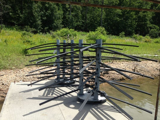 """Artificial fish habitat """"trees"""" made of PVC pipe are ready to be dropped into Norfork Lake."""