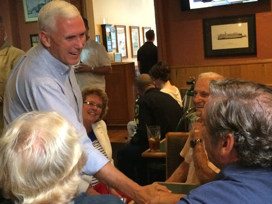 Pence shakes a hand at Price Hill Chili.