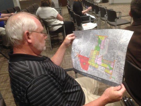 Murfreesboro Planning Director Gary Whitaker examines