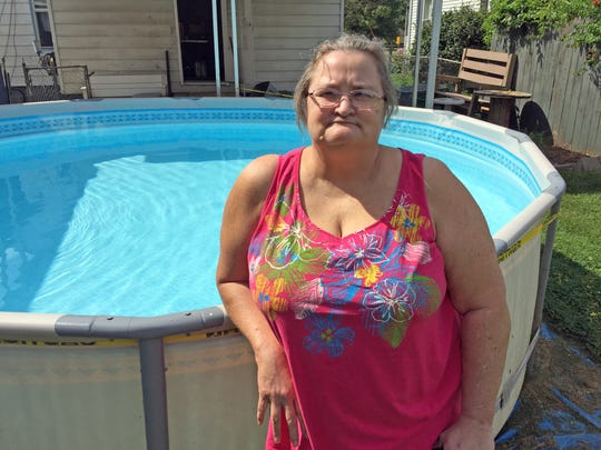 Veronica Goltz stands by the pool in her backyard.