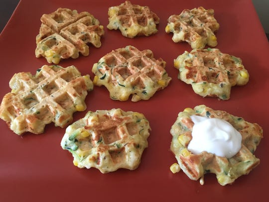 Zucchini and Corn Fritters may be garnished with sour cream or ricotta.