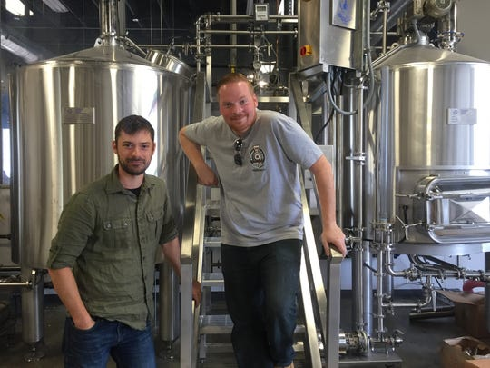 Chris Mazzone (left) and Chris Burke, owners of Eight & Sand Beer Company, more than doubled the brewery's capacity in late summer.