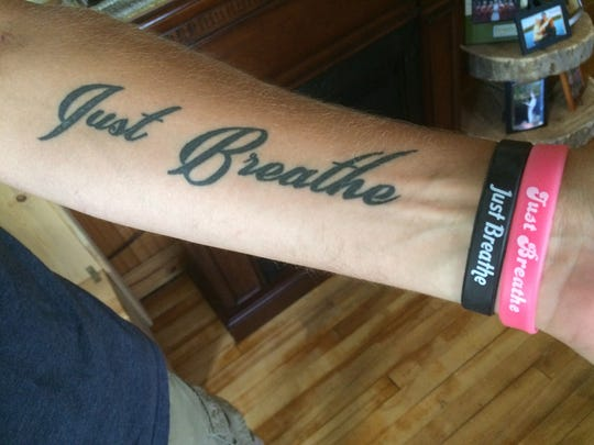 A tattoo on Justin Norenberg's left forearm sums up his philosophy in dealing with cystic fibrosis.