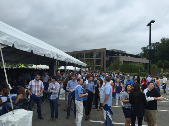 Wyndham Worldwide employees gather for a pep rally to celebrate the company's 10th anniversary at its world headquarters in Parsippany on Aug. 10, 2016.