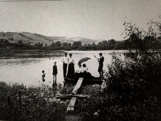 A group swimming in the Susquehanna River, around 1905.