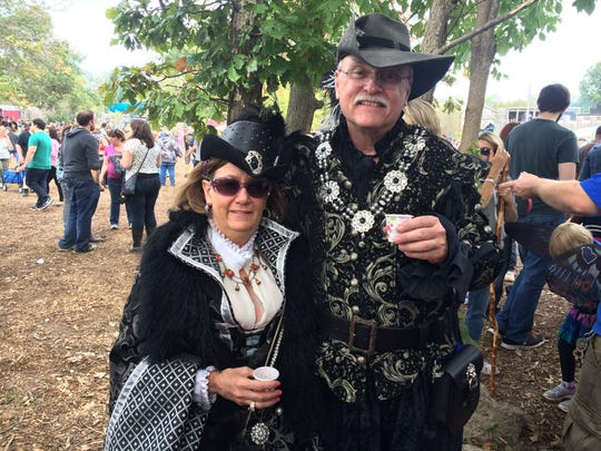 Costumed revelers lends color and atmosphere to the Michigan Renaissance Festival.