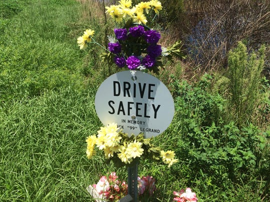 Memorial signs dot the landscape off SR 82 in Lee County, where more than two dozen people have been killed in traffic-related accidents in the past five years.