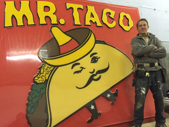 Bill Bonofiglo poses in front of a Mr. Taco sign. Bonofiglo plans to reopen the fast food restaurant, which has a loyal local following.