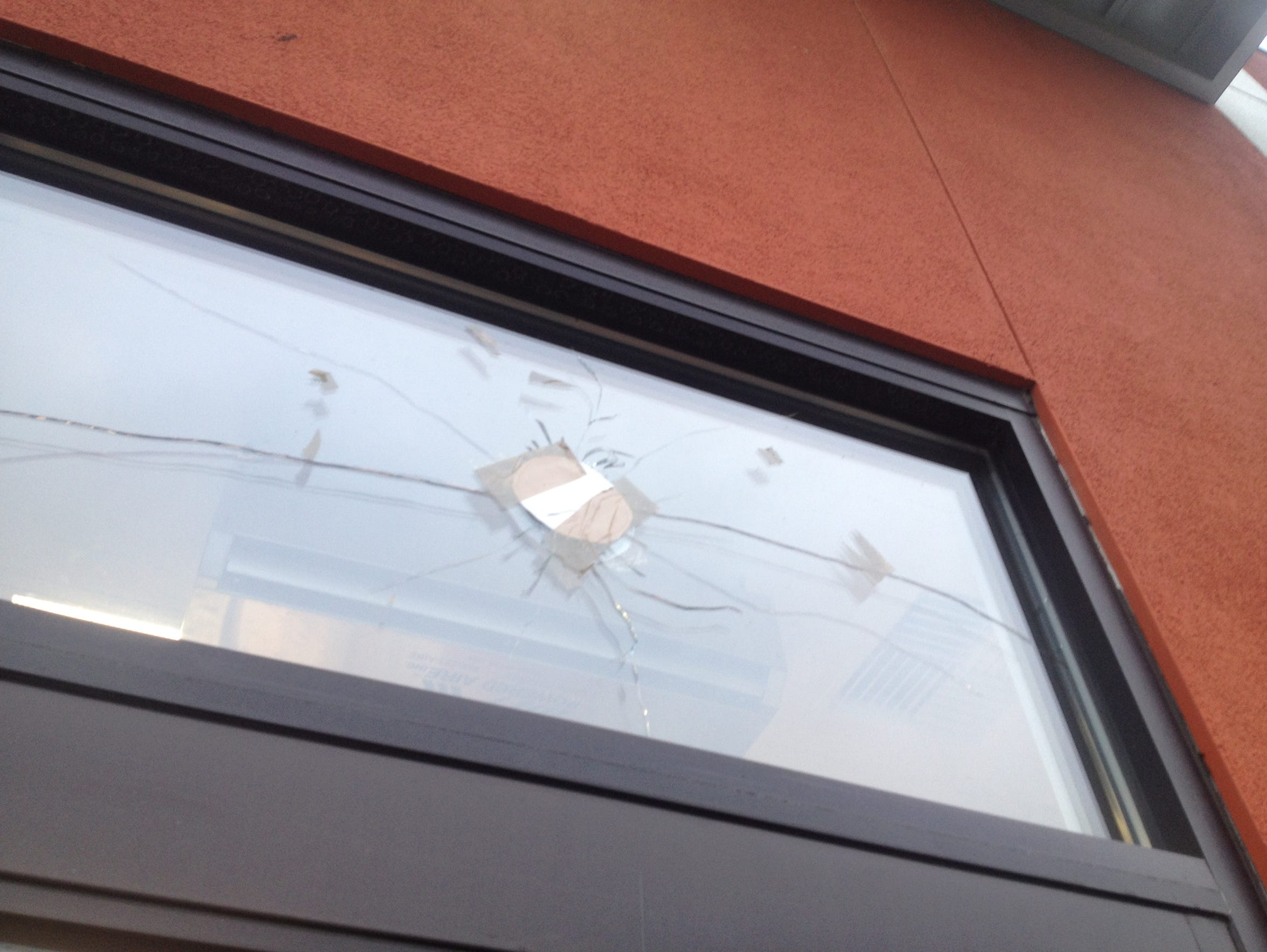 A bullet hole remains in the glass above the drive-thru window of the McDonald's on Williams Road from a shooting two years ago.