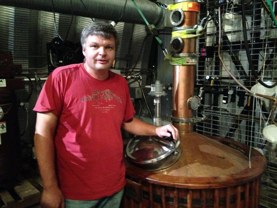 Sam Bryant is pictured with one of four stills at Samuel T. Bryant Distillery LLC, 1331 Lower Brownsville Road.