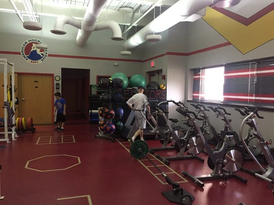 Fans explore the fitness room in the Binghamton Senators locker room on Saturday.