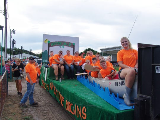 Avondale 4-H members ride in the parade during the opening ceremony of the 170th Muskingum County Blue Ribbon Fair.
