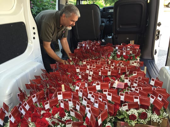 John Acklin loading roses to be delivered to teachers