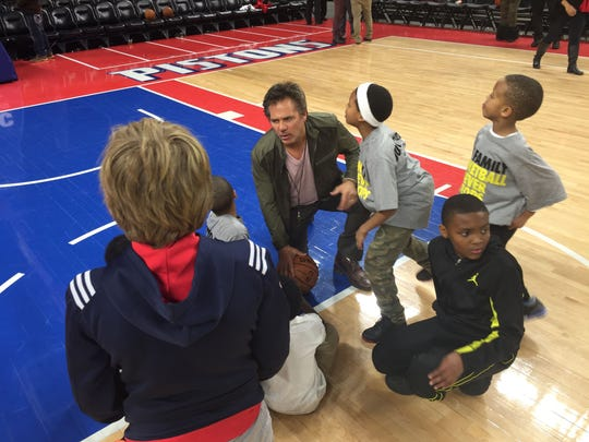 Pistons owner Tom Gores with a few kids at the Palace.