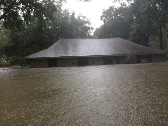 A home off of E. Bayou Pkwy in Lafayette is flooded up to the roof top.