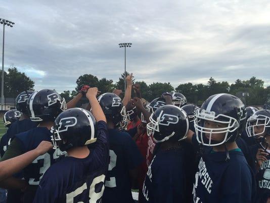 Poughkeepsie-football-huddle.JPG