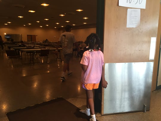 Hundreds of people left homeless by floodwaters have been taken in at the Red Cross shelter at the Heymann Performing Arts Center.