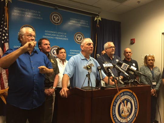 Gov. John Bel Edwards, center, and FEMA Administrator