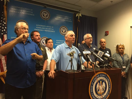 Gov. John Bel Edwards, center, and FEMA Administrator Craig Fugate provided flooding updates during a press conference in Baton Rouge Tuesday morning.