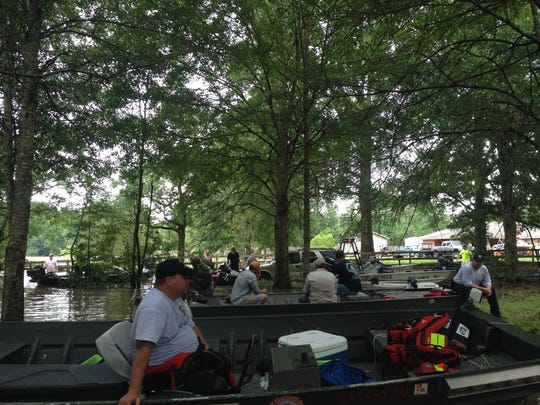 Alexandria Fire Department Capt. Chris Mitchum (foreground) and other first-responders await assignments for search-and-rescue missions in South Louisiana. The Alexandria Fire Department is among several departments in Central Louisiana which have sent personnel to assist in flood rescue and recovery operations.