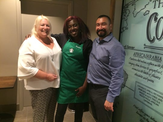 Starbucks store manager Sue Cerminar (left),  barista