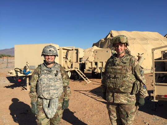Lt. Col. Susan Manion, left, and Capt. Kelcee Capurs stand outside the brigade's battlefield headquarters known as a Tactical Operations Center, or TOC.