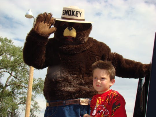 Smokey Bear waves to the crowd in the parade in Carrizozo Saturday.