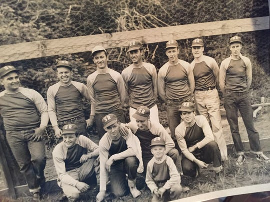 Jerry Bergquist, pictured in the front row of this photograph, was 5 years old when he was the bat boy for his father's fast-pitch softball team. His father is in the back row on the far right.